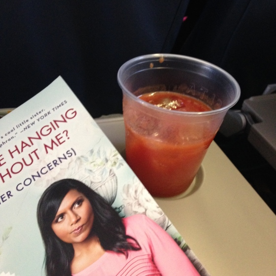 Reading and Tomato Juice on the flight